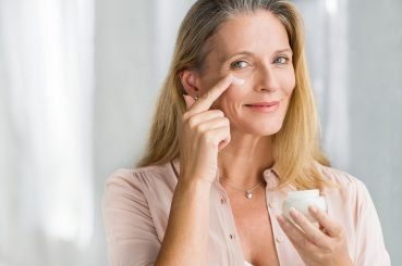 Woman applying eye creme